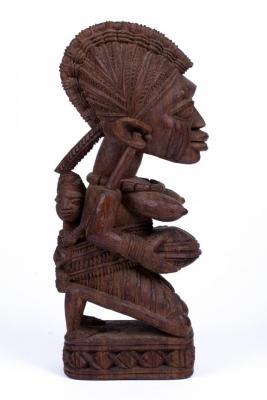Shrine Figure of a Kneeling Woman with Child and Covered Bowl