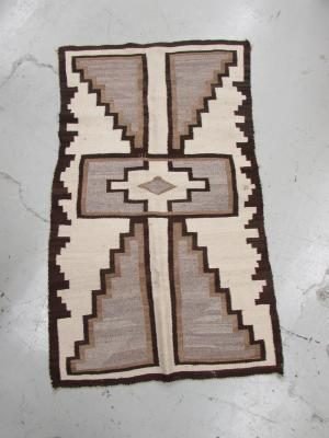 Rug with Stepped Triangles and Central Medallion